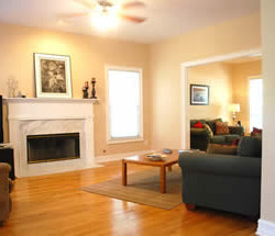 Warm and inviting after changing paint color to a lighter shade that will appeal to a buyer.